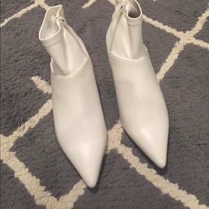 White pointy toe bootie.   Never been worn.